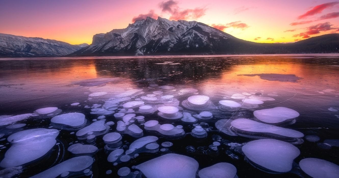 Guide To Visiting Abraham Lake And Its Unusual Frozen Bubbles